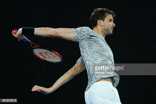 Grigor Dimitrov of Bulgaria plays a backhand in his semifinal match against Rafael Nadal of Spain on day 12 of the 2017 Australian Open at Melbourne...