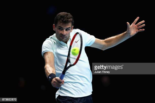 Grigor Dimitrov of Bulgaria plays a backhand in his Singles match against Dominic Thiem of Austria during day two of the Nitto ATP World Tour Finals...
