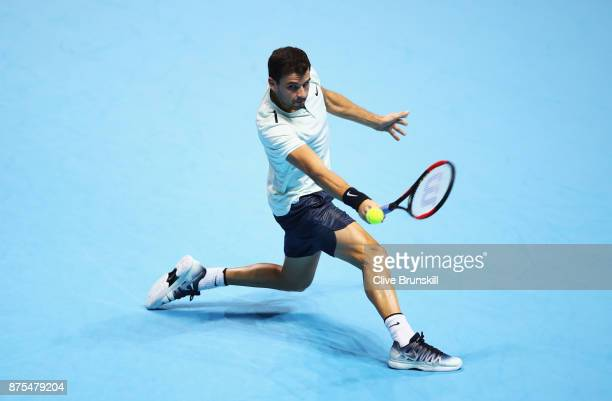 Grigor Dimitrov of Bulgaria plays a backhand in his Singles match against Pablo Carreno Busta of Spain during day six of the Nitto ATP World Tour...