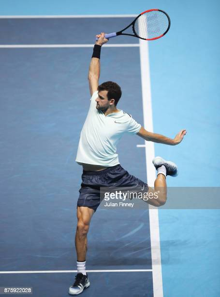 Grigor Dimitrov of Bulgaria plays a backhand in his Singles Semi Final match against Jack Sock of the United States during day seven of the Nitto ATP...