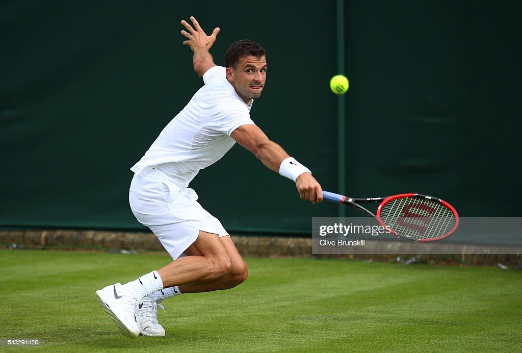 <a gi-track='captionPersonalityLinkClicked' href=/galleries/search?phrase=Grigor+Dimitrov&family=editorial&specificpeople=4332557 ng-click='$event.stopPropagation()'>Grigor Dimitrov</a> of Bulgaria plays a backhand shot during the Men's Singles first round match against Bjorn Fratangelo of The United States on day one of the Wimbledon Lawn Tennis Championships at the All England Lawn Tennis and Croquet Club on June 27th, 2016 in London, England.