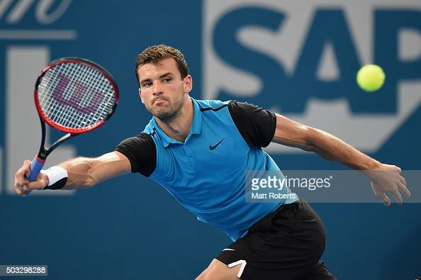 Grigor Dimitrov of Bulgaria plays a forehand against Gilles Simon of France during day two of the 2016 Brisbane International at Pat Rafter Arena on...