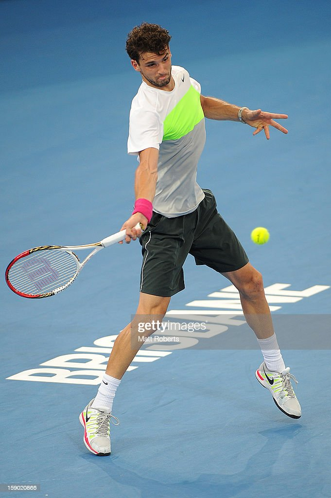 Grigor Dimitrov of Bulgaria plays a forehand during his final match against Andy Murray of Great Britain on day eight of the Brisbane International at Pat Rafter Arena on January 6, 2013 in Brisbane, Australia.