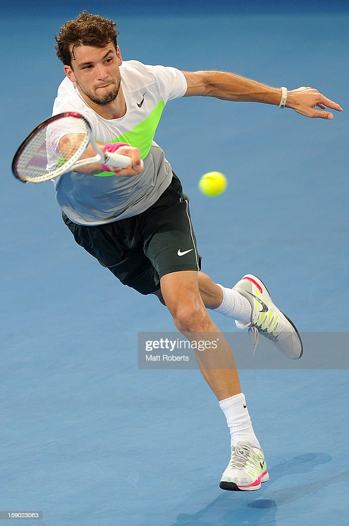 <a gi-track='captionPersonalityLinkClicked' href=/galleries/search?phrase=Grigor+Dimitrov&family=editorial&specificpeople=4332557 ng-click='$event.stopPropagation()'>Grigor Dimitrov</a> of Bulgaria plays a forehand during his final match against Andy Murray of Great Britain on day eight of the Brisbane International at Pat Rafter Arena on January 6, 2013 in Brisbane, Australia.