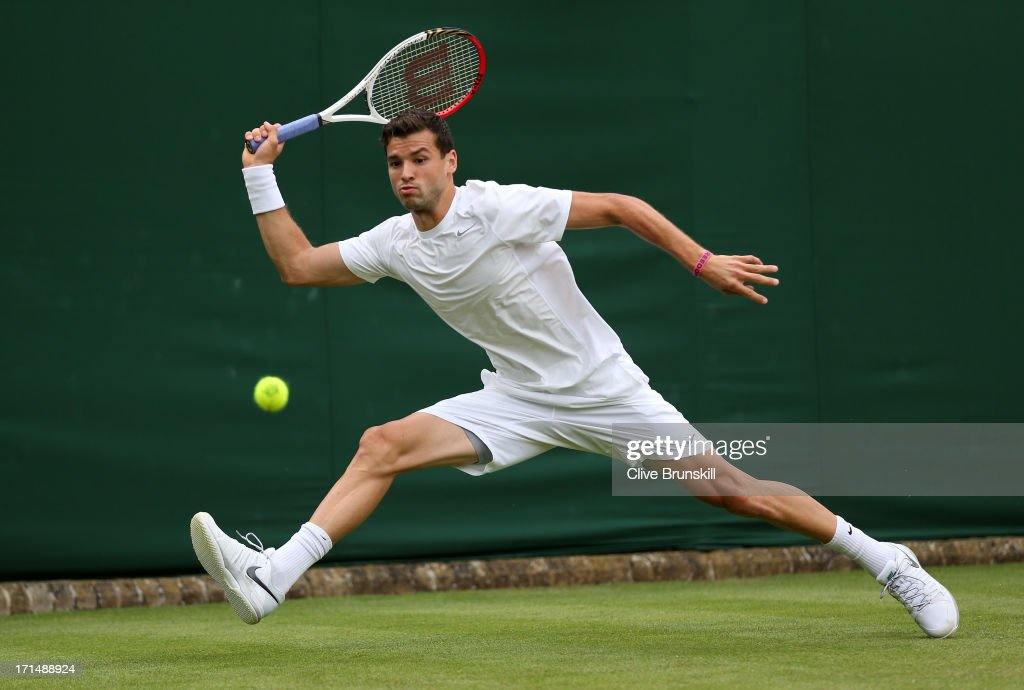 <a gi-track='captionPersonalityLinkClicked' href=/galleries/search?phrase=Grigor+Dimitrov&family=editorial&specificpeople=4332557 ng-click='$event.stopPropagation()'>Grigor Dimitrov</a> of Bulgaria plays a forehand during his Gentlemen's Singles first round match against Simone Bolelli of Italy on day two of the Wimbledon Lawn Tennis Championships at the All England Lawn Tennis and Croquet Club on June 25, 2013 in London, England.