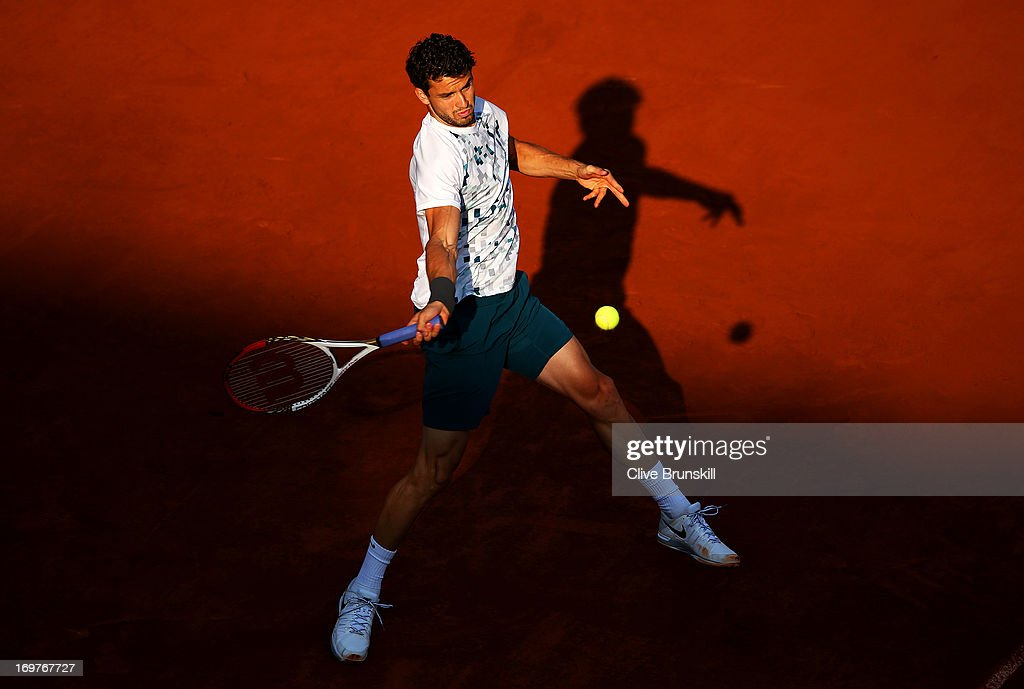 Grigor Dimitrov of Bulgaria plays a forehand during his Men's Singles match against Novak Djokovic of Serbia on day seven of the French Open at Roland Garros on June 1, 2013 in Paris, France.