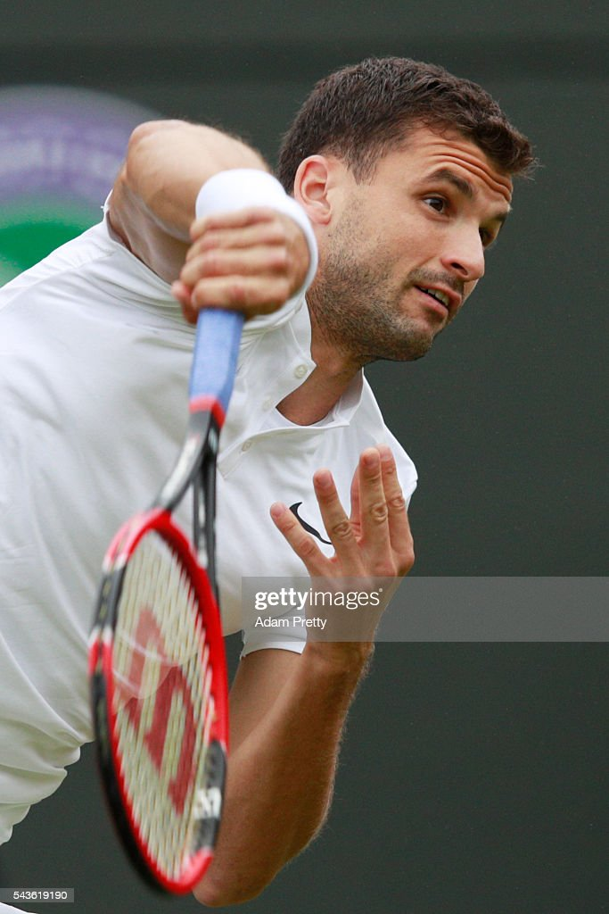 <a gi-track='captionPersonalityLinkClicked' href=/galleries/search?phrase=Grigor+Dimitrov&family=editorial&specificpeople=4332557 ng-click='$event.stopPropagation()'>Grigor Dimitrov</a> of Bulgaria plays a forehand during the Men's Singles second round match against Gilles Simon of France on day three of the Wimbledon Lawn Tennis Championships at the All England Lawn Tennis and Croquet Club on June 29, 2016 in London, England.