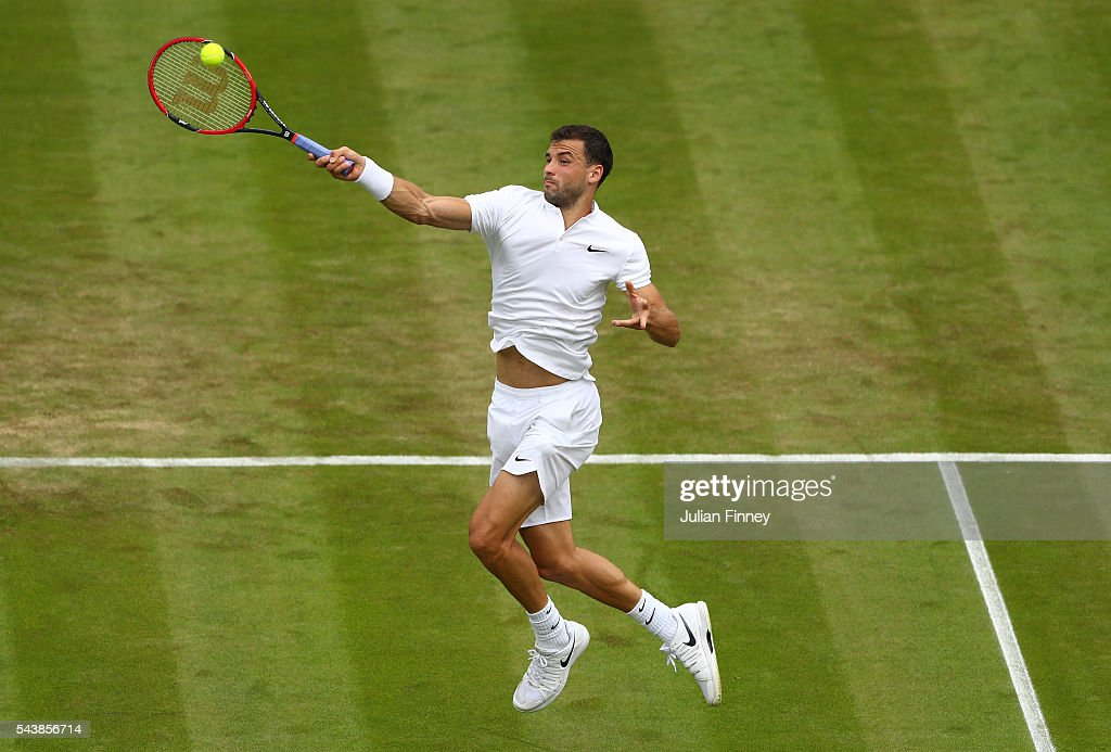 Grigor Dimitrov of Bulgaria plays a forehand during the Men's Singles second round match against Gilles Simon of France on day four of the Wimbledon Lawn Tennis Championships at the All England Lawn Tennis and Croquet Club on June 30, 2016 in London, England.