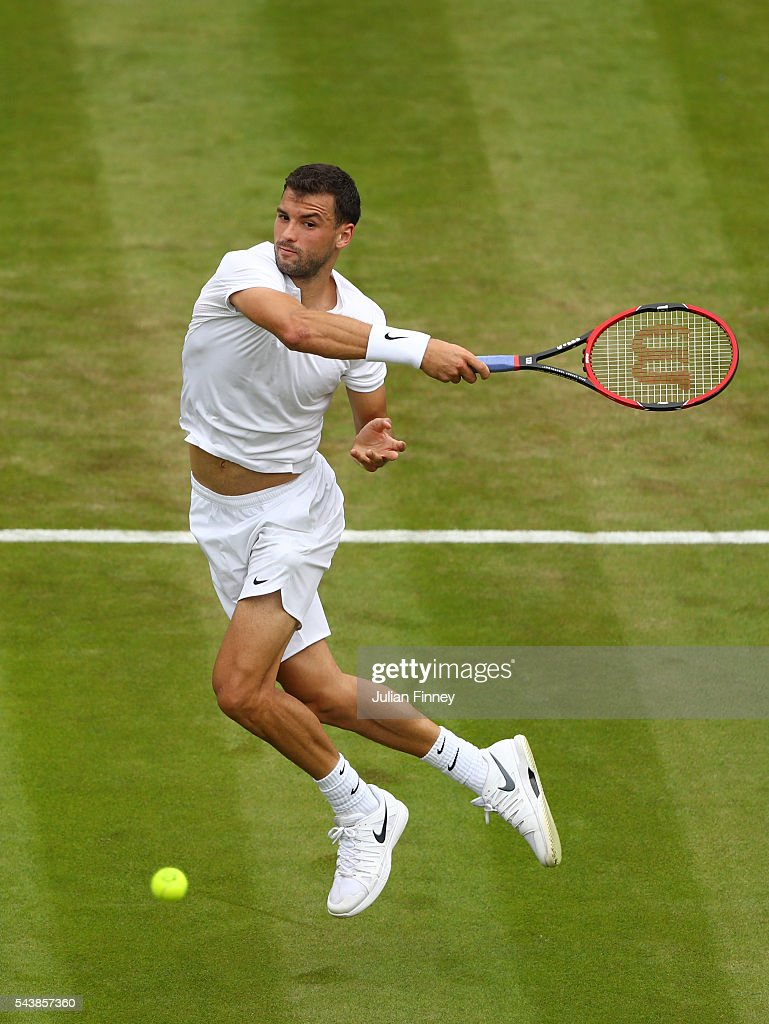 <a gi-track='captionPersonalityLinkClicked' href=/galleries/search?phrase=Grigor+Dimitrov&family=editorial&specificpeople=4332557 ng-click='$event.stopPropagation()'>Grigor Dimitrov</a> of Bulgaria plays a forehand during the Men's Singles second round match against Gilles Simon of France on day four of the Wimbledon Lawn Tennis Championships at the All England Lawn Tennis and Croquet Club on June 30, 2016 in London, England.