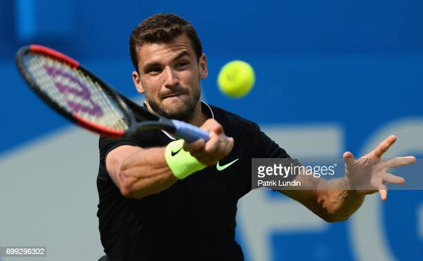 Grigor Dimitrov of Bulgaria plays a forehand during the mens singles second round match against Julien Benneteau of France on day three of the 2017...