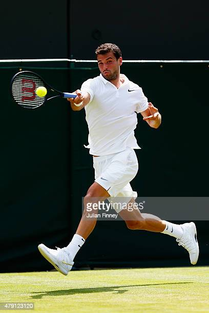 Grigor Dimitrov of Bulgaria plays a forehand in his Gentlemens Singles Second Round match against Steve Johnson of the United States during day three...
