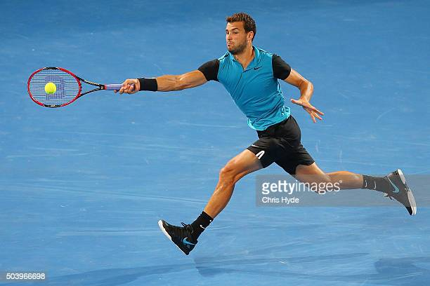 Grigor Dimitrov of Bulgaria plays a forehand in his quarter final match against Roger Federer of Switzerland during day six of the 2016 Brisbane...