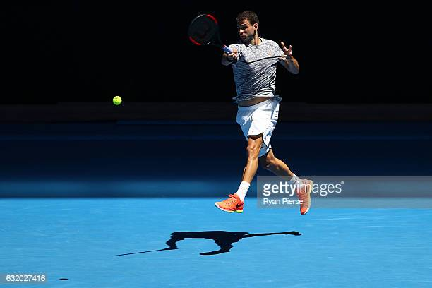 Grigor Dimitrov of Bulgaria plays a forehand in his second round match against Hyeon Chung of Korea on day four of the 2017 Australian Open at...