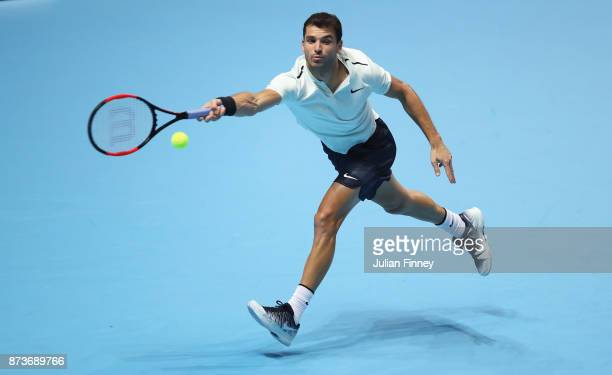 Grigor Dimitrov of Bulgaria plays a forehand in his Singles match against Dominic Thiem of Austria during day two of the Nitto ATP World Tour Finals...