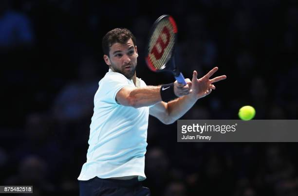 Grigor Dimitrov of Bulgaria plays a forehand in his Singles match against Pablo Carreno Busta of Spain during day six of the Nitto ATP World Tour...