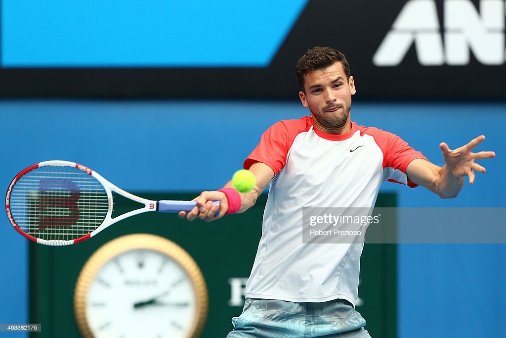 Grigor Dimitrov of Bulgaria plays a forehand in his third round match against Milos Raonic of Canada during day six of the 2014 Australian Open at Melbourne Park on January 18, 2014 in Melbourne, Australia.