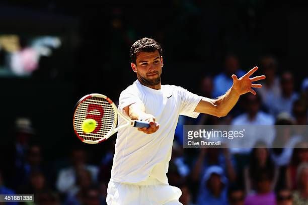 Grigor Dimitrov of Bulgaria plays a forehand return during his Gentlemen's Singles semifinal match against Novak Djokovic of Serbia on day eleven of...