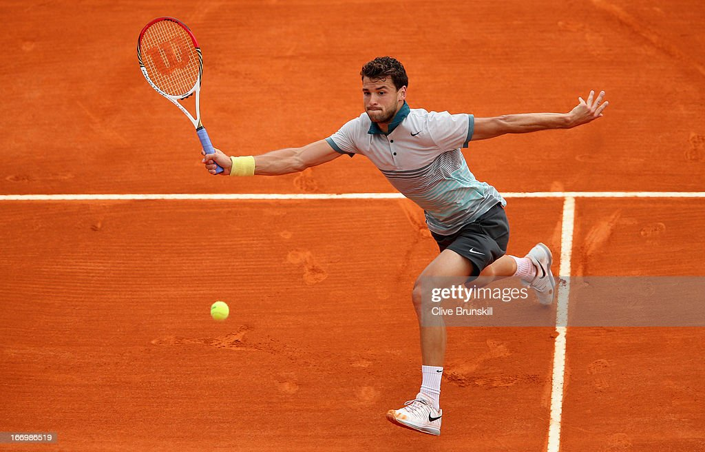 <a gi-track='captionPersonalityLinkClicked' href=/galleries/search?phrase=Grigor+Dimitrov&family=editorial&specificpeople=4332557 ng-click='$event.stopPropagation()'>Grigor Dimitrov</a> of Bulgaria plays a forehand volley against Rafael Nadal of Spain in their quarter final match during day six of the ATP Monte Carlo Masters, at Monte-Carlo Sporting Club on April 19, 2013 in Monte-Carlo, Monaco.
