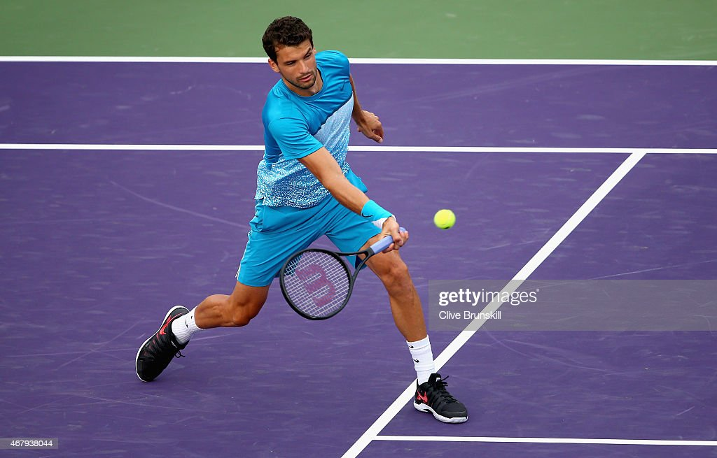 Grigor Dimitrov of Bulgaria plays a forehand volley against Vasek Pospisil of Canada in their secoind round match during the Miami Open Presented by...