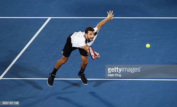 Grigor Dimitrov of Bulgaria plays a forehand volley in the mens final match against Viktor Troicki of Serbia during day seven of the 2016 Sydney...