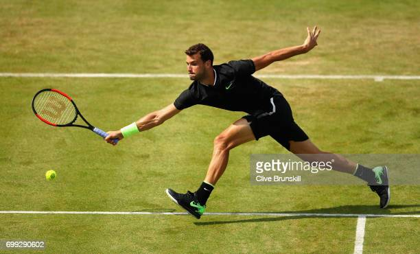 Grigor Dimitrov of Bulgaria plays a volley during the mens singles second round match against Julien Benneteau of France on day three of the 2017...