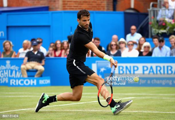 Grigor Dimitrov of Bulgaria plays a volley during the mens singles quarter final match against Daniil Medvedev of Russia on day five of the 2017...