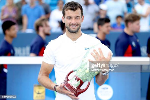 Grigor Dimitrov of Bulgaria poses for photographers after his win over Nick Kyrgios of Australia during the men's final on day 9 of the Western...