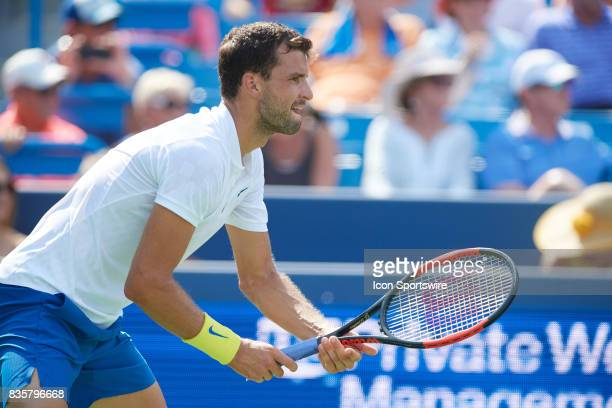 Grigor Dimitrov of Bulgaria prepares to receive a serve his semifinal match against John Isner of the United States in the Western Southern Open at...