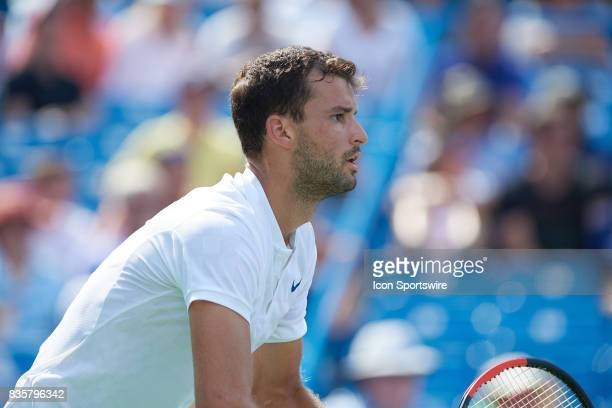 Grigor Dimitrov of Bulgaria prepares to return serve during his semifinal match against John Isner of the United States in the Western Southern Open...