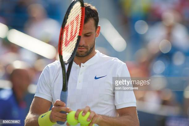 Grigor Dimitrov of Bulgaria prepares to serve to Nick Kyrgios of Australia during the men's finals in the Western Southern Open at the Lindner Family...