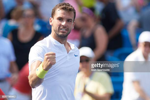 Grigor Dimitrov of Bulgaria pumps his fist after winning his semifinal match against John Isner of the United States in the Western Southern Open at...