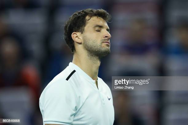 Grigor Dimitrov of Bulgaria reacts after losing the point during Men's singles quarter final mach against Rafael Nadal of Spain on day six of 2017...