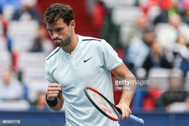 Grigor Dimitrov of Bulgaria reacts after winning a point during the Men's singles quarterfinal match against Rafael Nadal of Spain on day 6 of 2017...