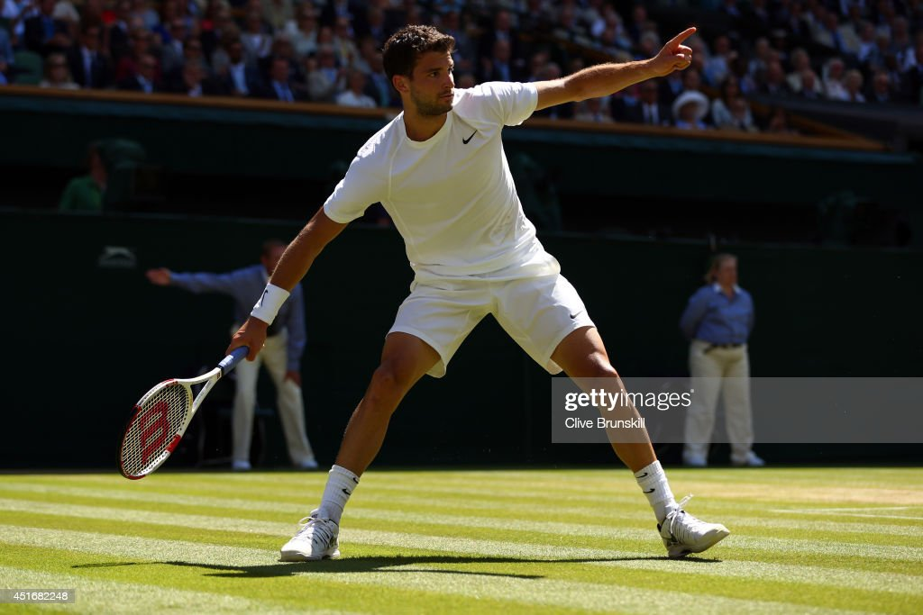 <a gi-track='captionPersonalityLinkClicked' href=/galleries/search?phrase=Grigor+Dimitrov&family=editorial&specificpeople=4332557 ng-click='$event.stopPropagation()'>Grigor Dimitrov</a> of Bulgaria reacts during his Gentlemen's Singles semi-final match against Novak Djokovic of Serbia on day eleven of the Wimbledon Lawn Tennis Championships at the All England Lawn Tennis and Croquet Club on July 4, 2014 in London, England.