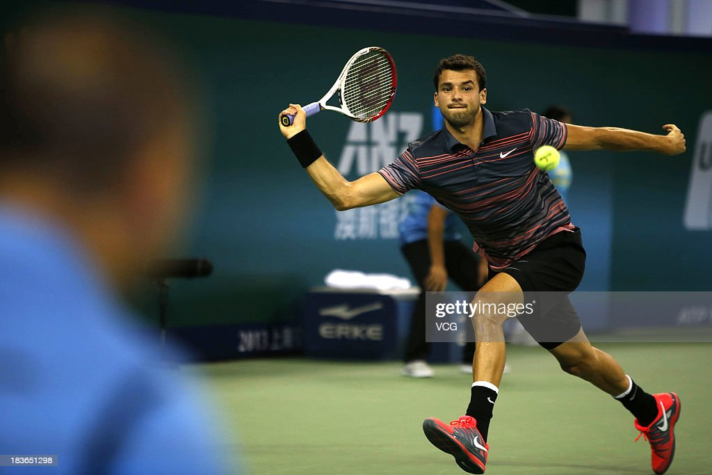<a gi-track='captionPersonalityLinkClicked' href=/galleries/search?phrase=Grigor+Dimitrov&family=editorial&specificpeople=4332557 ng-click='$event.stopPropagation()'>Grigor Dimitrov</a> of Bulgaria returns a ball to Kei Nishikori of Japan on day two of the Shanghai Rolex Masters at the Qi Zhong Tennis Center on October 8, 2013 in Shanghai, China.