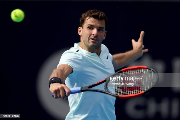 Grigor Dimitrov of Bulgaria returns a shot against Damir Dzumhur of Bosnia and Herzegovina on day four of the 2017 China Open at the China National...