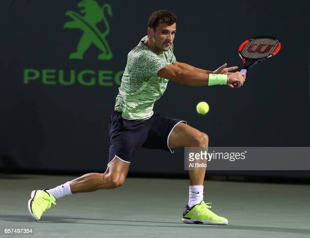 Grigor Dimitrov of Bulgaria returns a shot against Guido Pella of Argentina during day 5 of the Miami Open at Crandon Park Tennis Center on March 24...