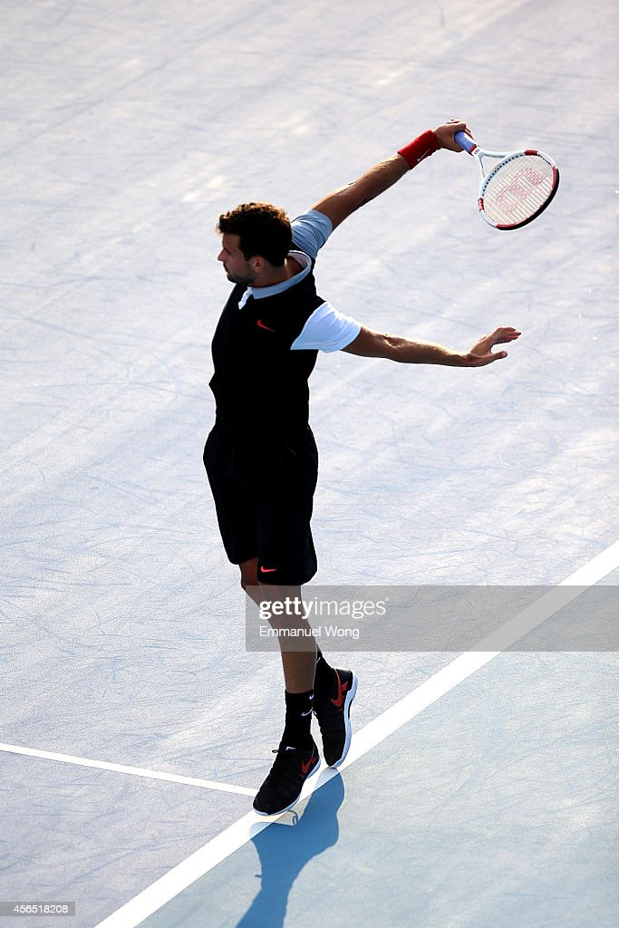 <a gi-track='captionPersonalityLinkClicked' href=/galleries/search?phrase=Grigor+Dimitrov&family=editorial&specificpeople=4332557 ng-click='$event.stopPropagation()'>Grigor Dimitrov</a> of Bulgaria returns a shot against Pablo Andujar of Spain during day six of the China Open at the China National Tennis Center on October 2, 2014 in Beijing, China.