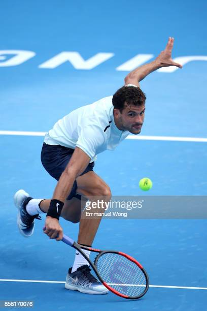 Grigor Dimitrov of Bulgaria returns a shot against Roberto Bautista Agut of Spain during the Men's Quarterfinal match on day seven of the 2017 China...