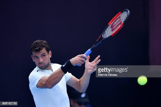 Grigor Dimitrov of Bulgaria returns a shot during his Men's singles quarterfinal match against Roberto Bautista Agut of Spain on day seven of the...