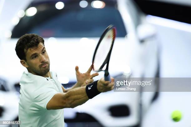 Grigor Dimitrov of Bulgaria returns a shot during Men's singles quarter final mach against Rafael Nadal of Spain on day six of 2017 ATP Shanghai...