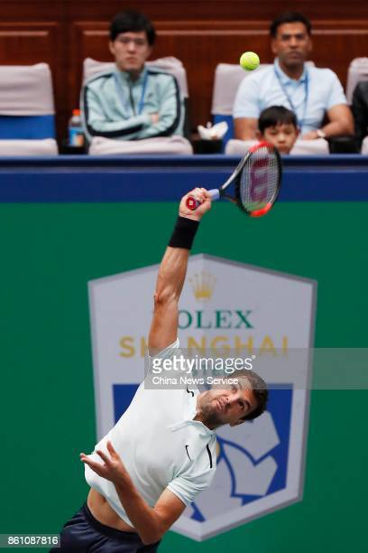 Grigor Dimitrov of Bulgaria returns a shot during Men's singles quarterfinal mach against Rafael Nadal of Spain on day six of 2017 ATP Shanghai Rolex...