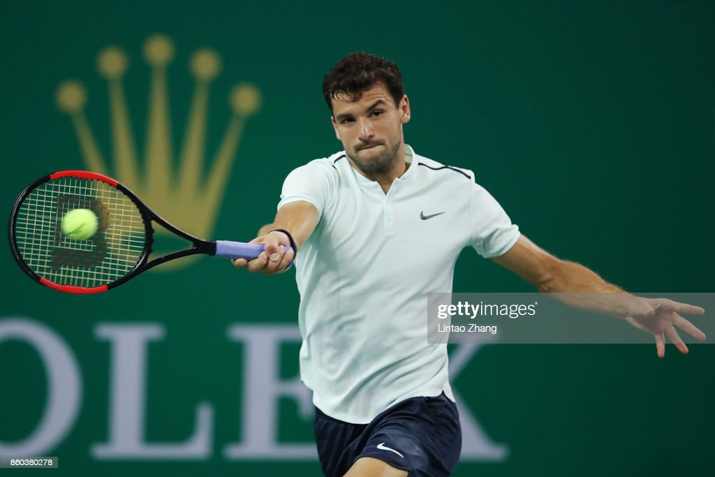 Grigor Dimitrov of Bulgaria returns a shot during the Men's singles mach third round against Sam Querrey of the United States on day five of 2017 ATP Shanghai Rolex Masters at Qizhong Stadium on October 12, 2017 in Shanghai, China.