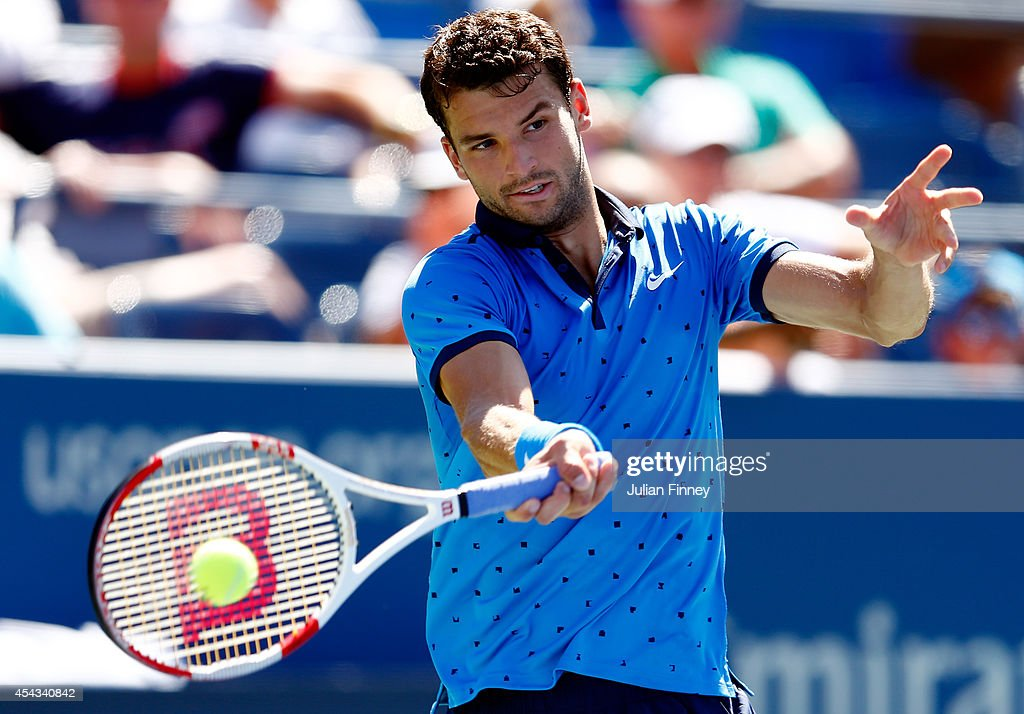 <a gi-track='captionPersonalityLinkClicked' href=/galleries/search?phrase=Grigor+Dimitrov&family=editorial&specificpeople=4332557 ng-click='$event.stopPropagation()'>Grigor Dimitrov</a> of Bulgaria returns a shot to Dudi Sela of Israel during their men's singles second round match on Day Five of the 2014 US Open at the USTA Billie Jean King National Tennis Center on August 29, 2014 in the Flushing neighborhood of the Queens borough of New York City.