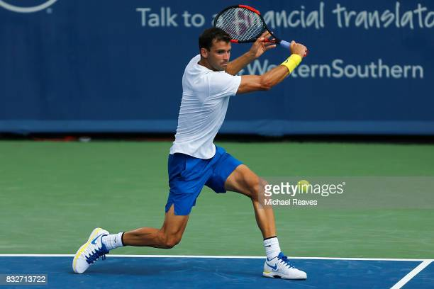 Grigor Dimitrov of Bulgaria returns a shot to Feliciano Lopez of Spain during Day 5 of the Western and Southern Open at the Lindner Family Tennis...