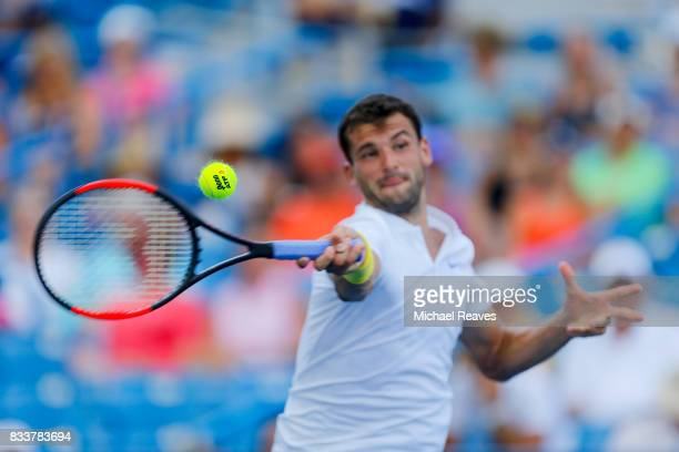 Grigor Dimitrov of Bulgaria returns a shot to Juan Martin Del Potro of Argentina during Day 6 of the Western and Southern Open at the Lindner Family...