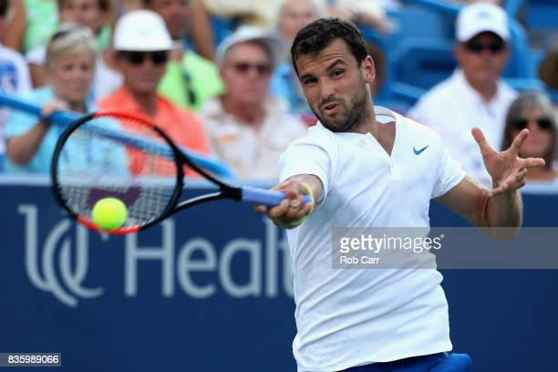 Grigor Dimitrov of Bulgaria returns a shot to Nick Kyrgios of Australia during the men's final during Day 9 of of the Western and Southern Open at...