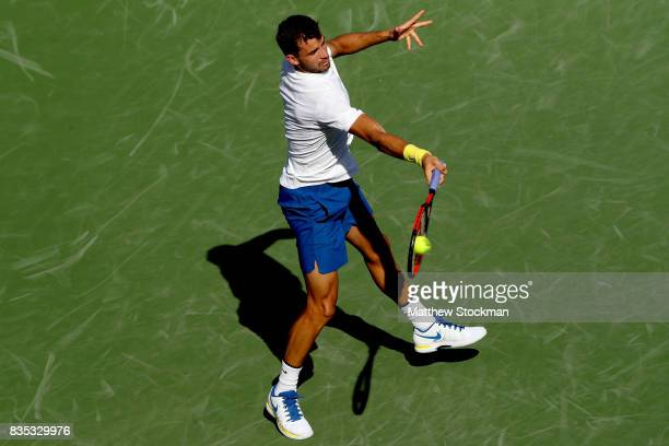 Grigor Dimitrov of Bulgaria returns a shot to Yuichi Sugita of Japan during day 7 of the Western Southern Open at the Lindner Family Tennis Center on...