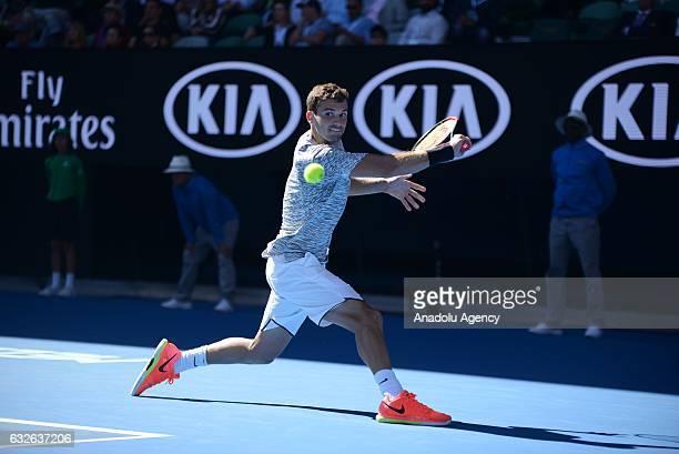 Grigor Dimitrov of Bulgaria returns the ball during his Australian Open Men's Singles quarterfinal match against David Goffin of Belgium at Rod Laver...
