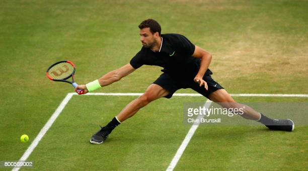 Grigor Dimitrov of Bulgaria returns the ball during the mens singles semifinal match against Feliciano Lopez of Spain on day six of the 2017 Aegon...